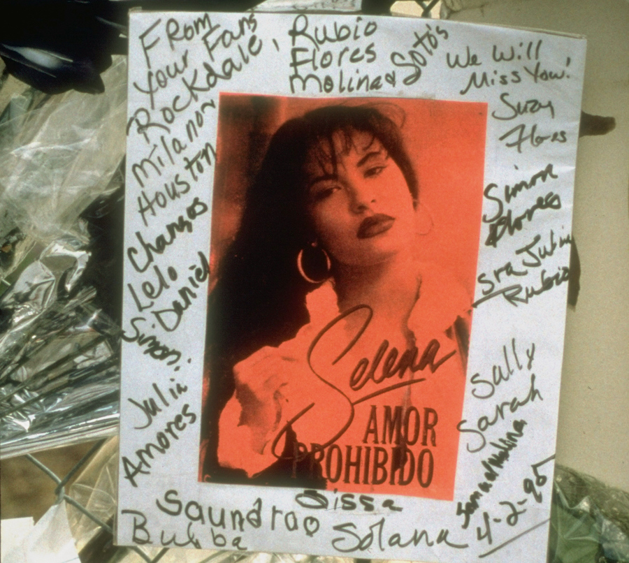 Pictures of Selena signed by fans outside of her place of death