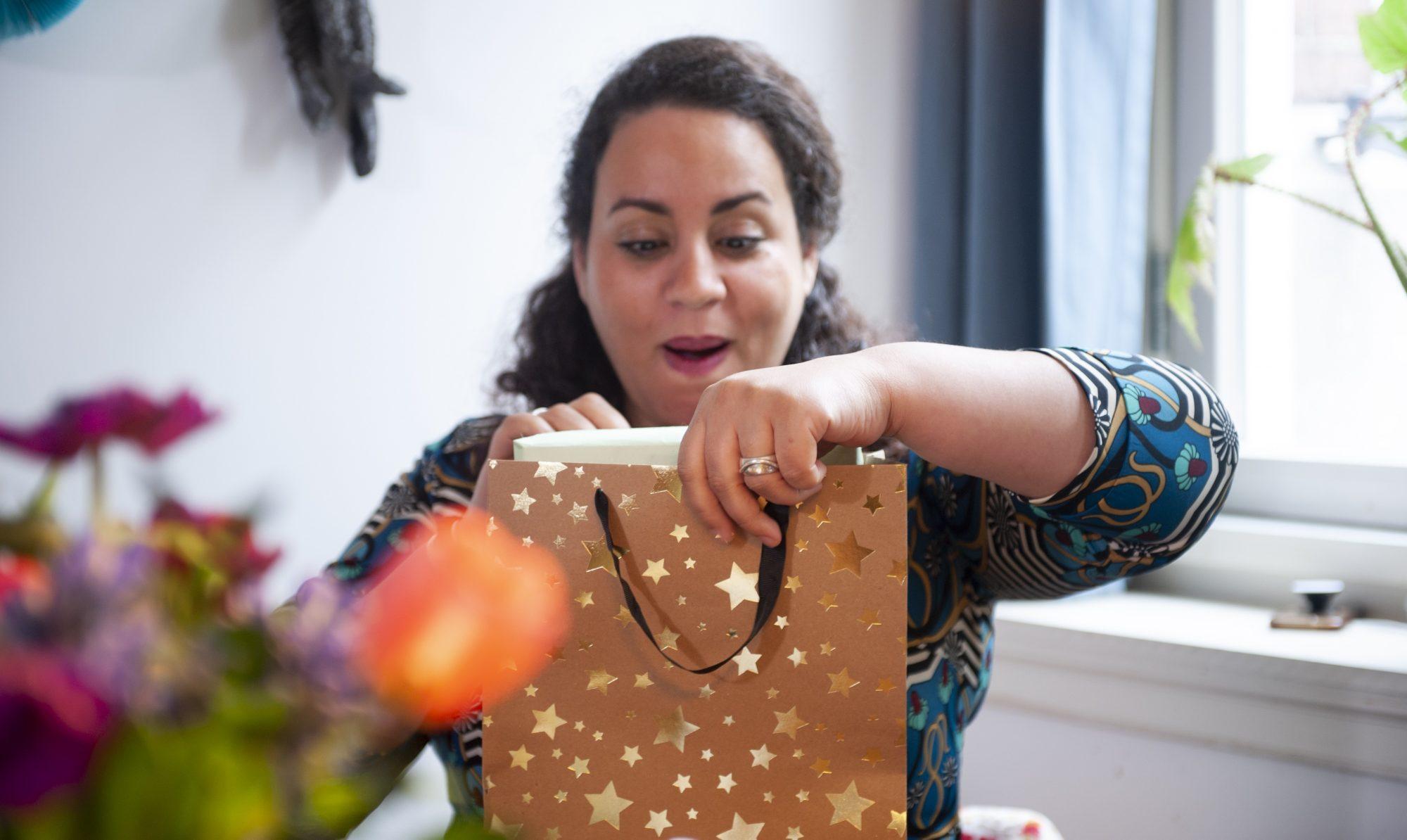 woman opening gift, satisfyer pro 2 vibrator