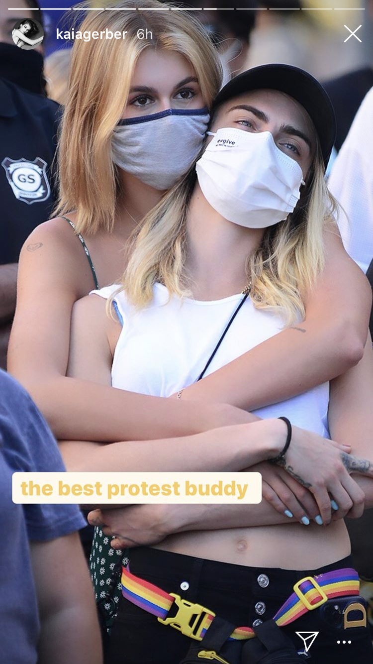 kaia gerber and cara delevingne protest