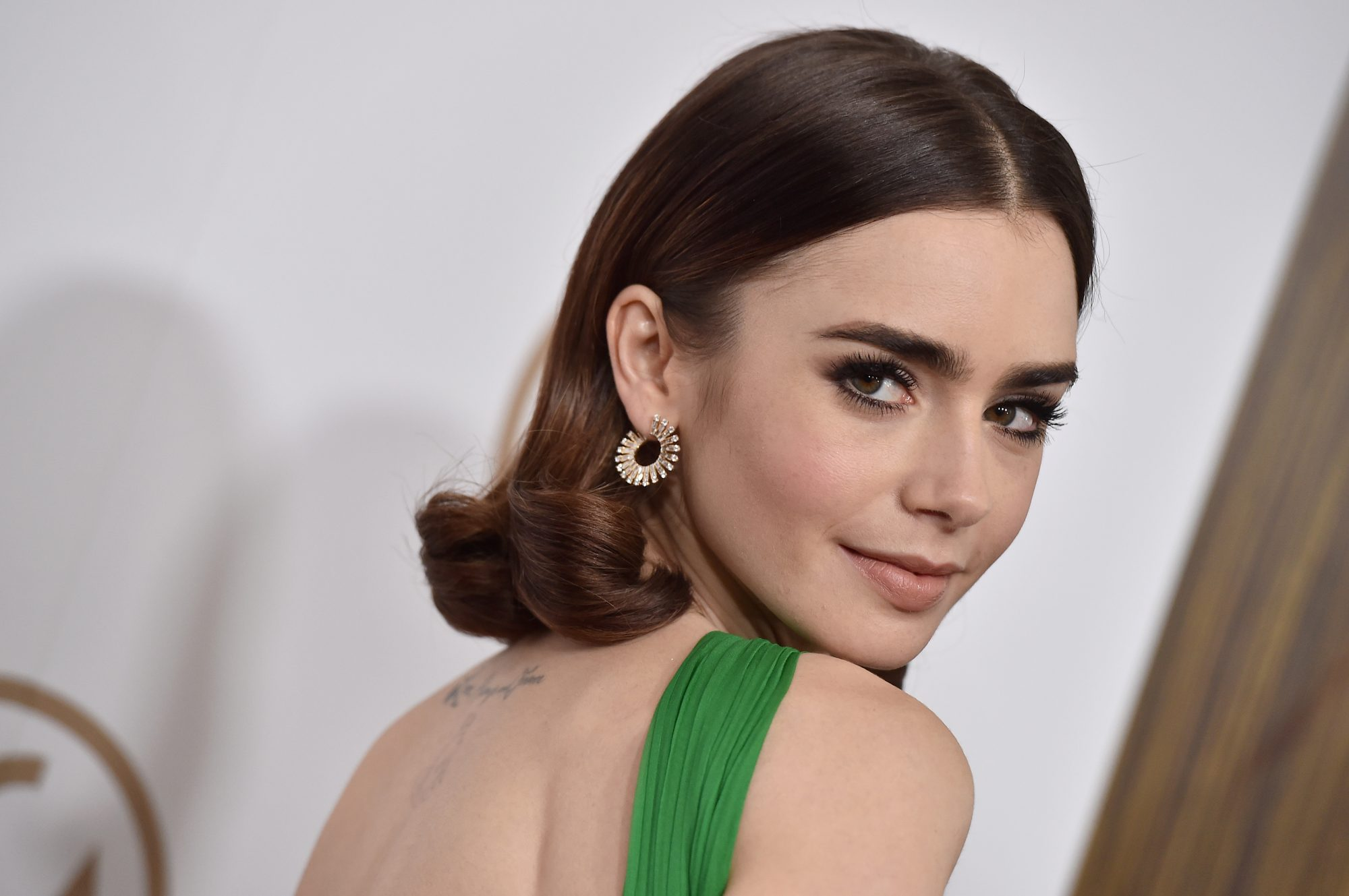 Lily Collins lancome anti-aging face serum