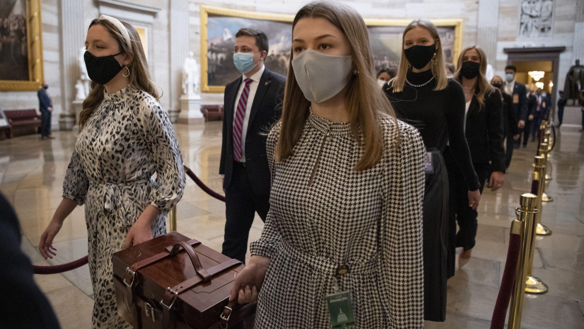 Senate aides carrying ballot boxes