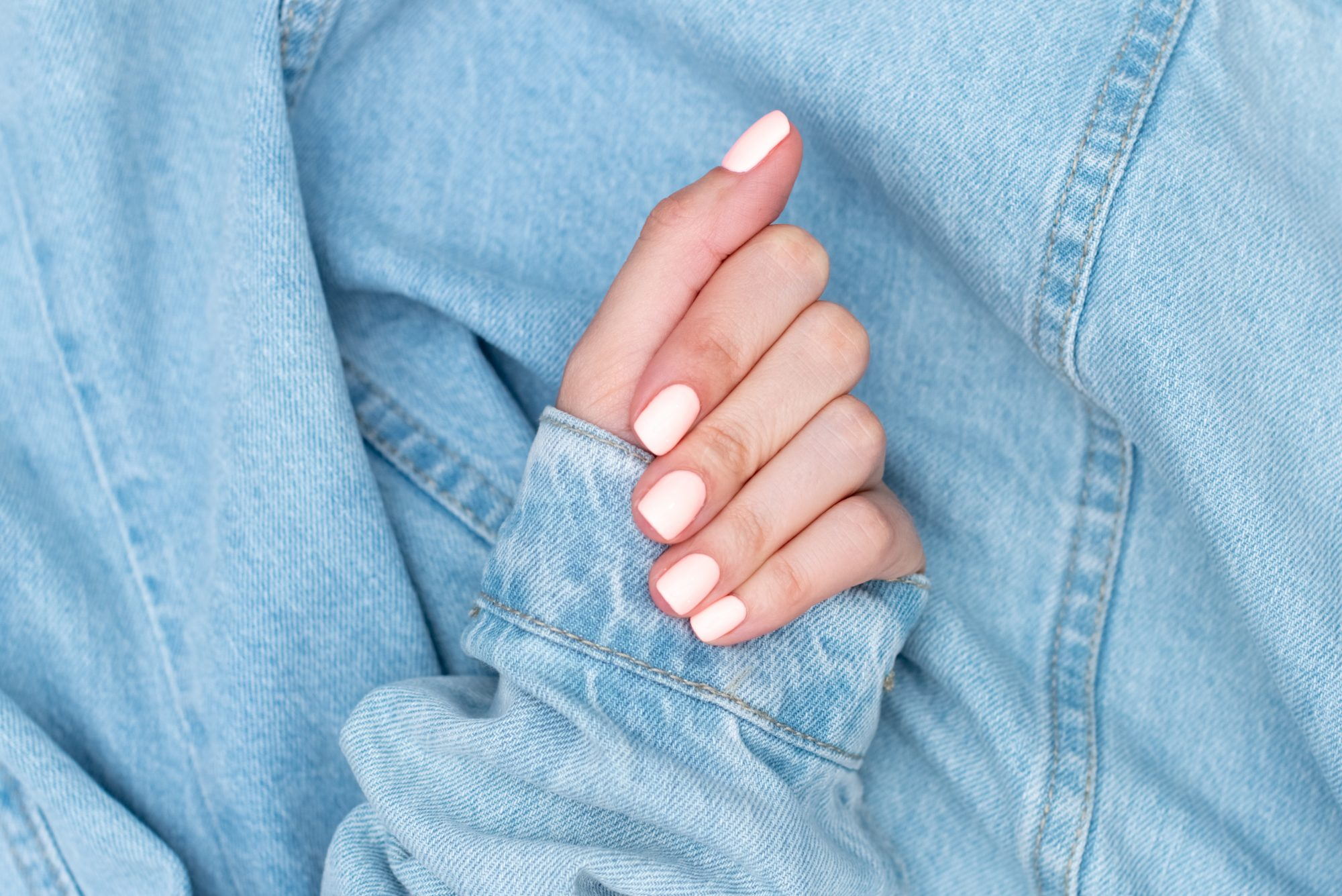 how to fix a broken nail, mainured hand on background