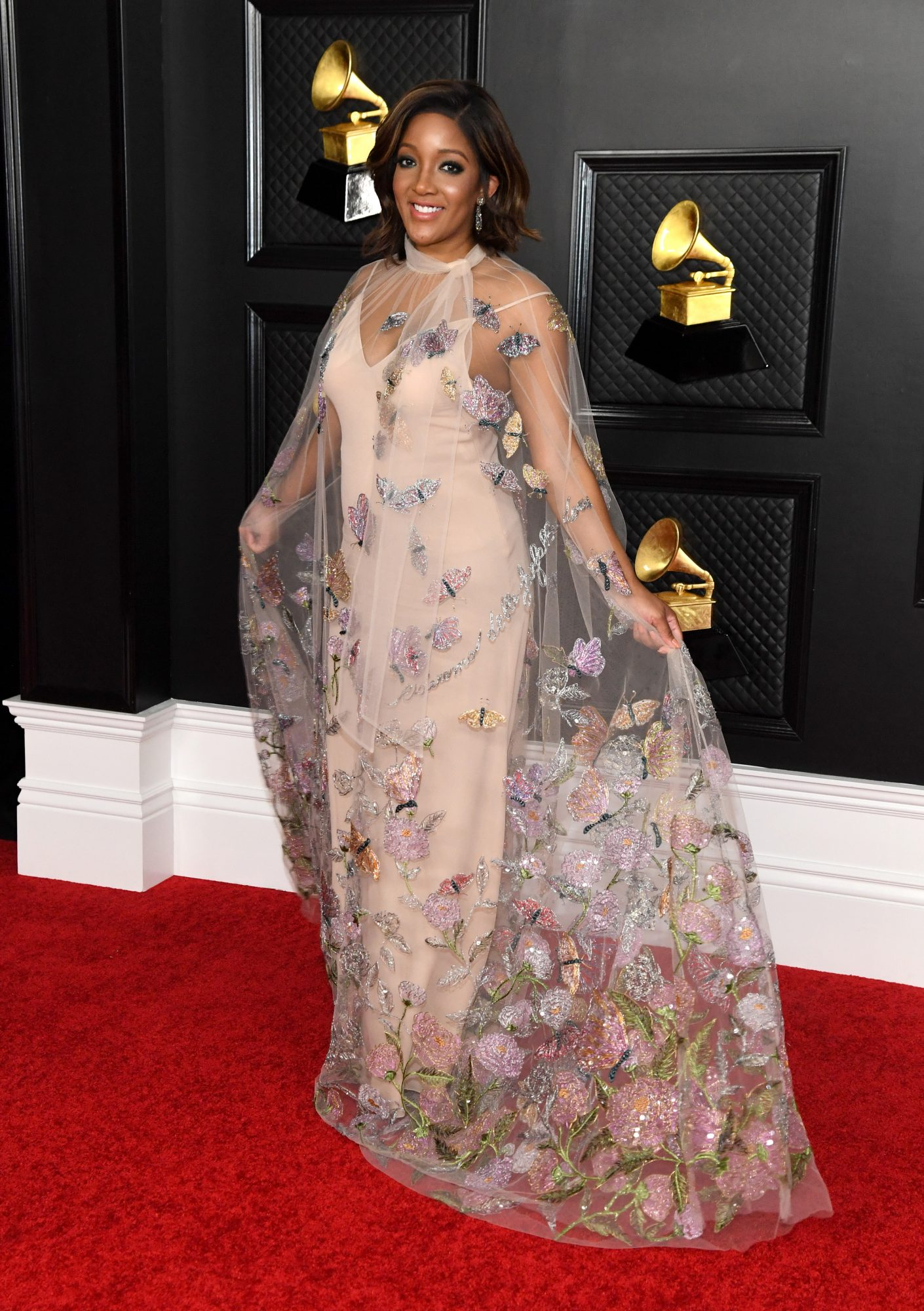 """Guynton is the first Black female solo artist to earn a nomination in a country category thanks to her song """"Black Like Me."""" To celebrate the occasion she wore a sheer Valentino dress with embroidered flowers."""
