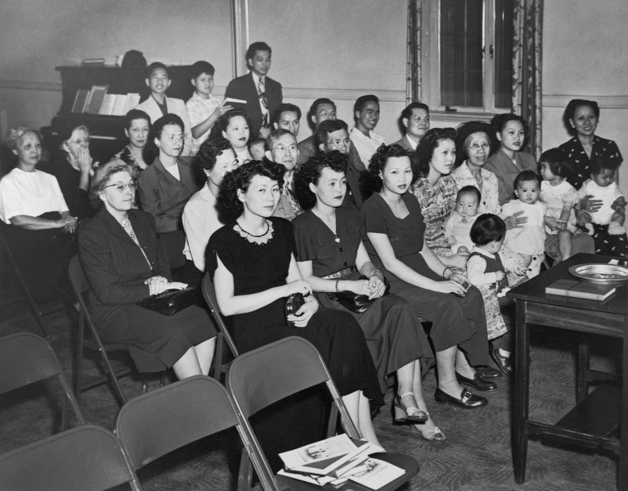 The wives of Chinese-American servicemen, who came to America as war brides after World War II, attend a Chinese-language Sunday school class at Westminster Presbyterian Church in Minneapolis in 1950.