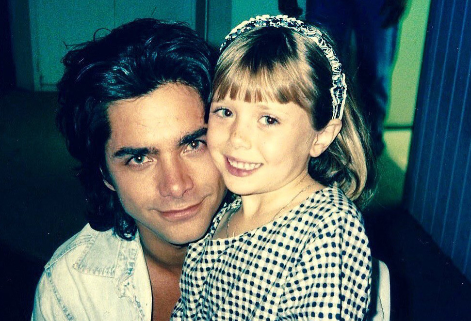John Stamos and Elizabeth Olsen on Full House set