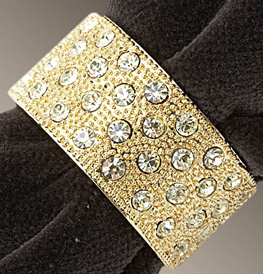 Five sets of four L'objet Gold Napkin Rings with Crystals