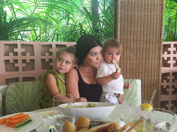 Kourtney Kardashian with Penelope and Reign