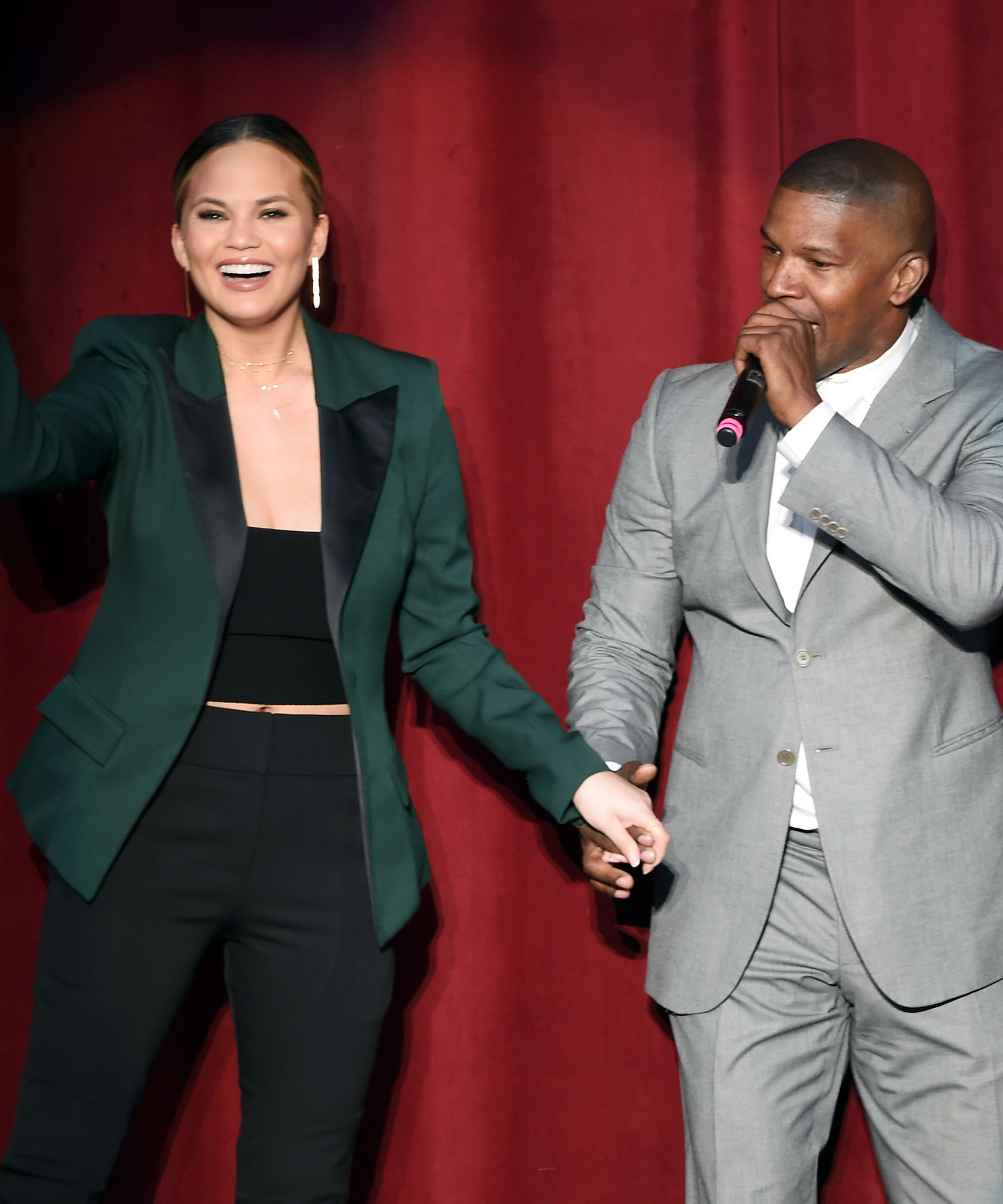 Actress Chrissy Teigen (L) and Jamie Foxx speak onstage during the 'Hillary Clinton: She's With Us' concert at The Greek Theatre on June 6, 2016 in Los Angeles, California.