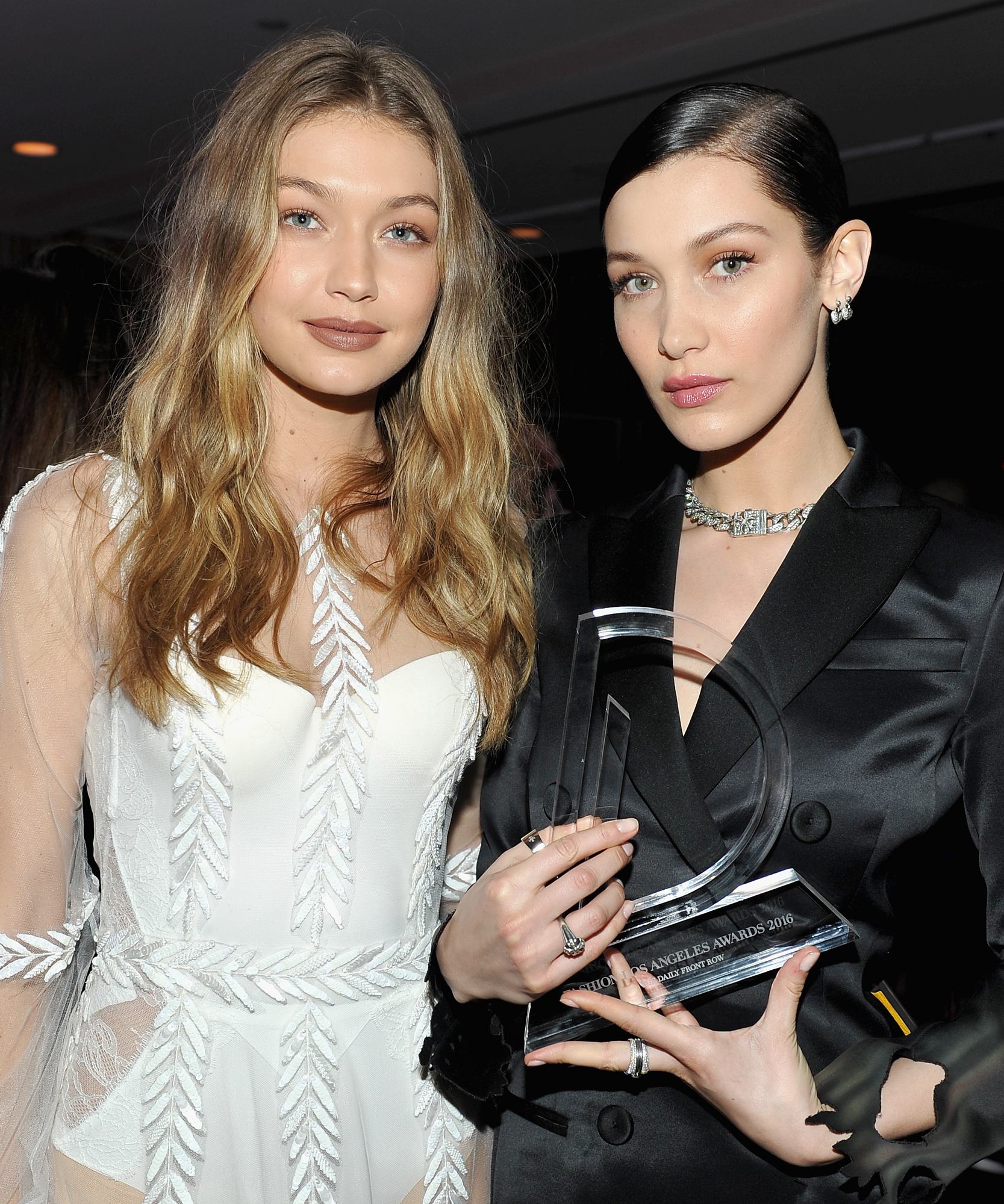 Models Gigi Hadid (L) and Bella Hadid, with her Model of the Year award, attend The Daily Front Row 'Fashion Los Angeles Awards' 2016 at Sunset Tower Hotel on March 20, 2016 in West Hollywood, California.