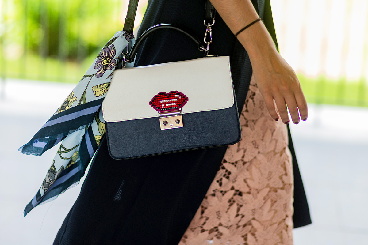 Add a classic feel to a cheeky bag with a floral scarf.