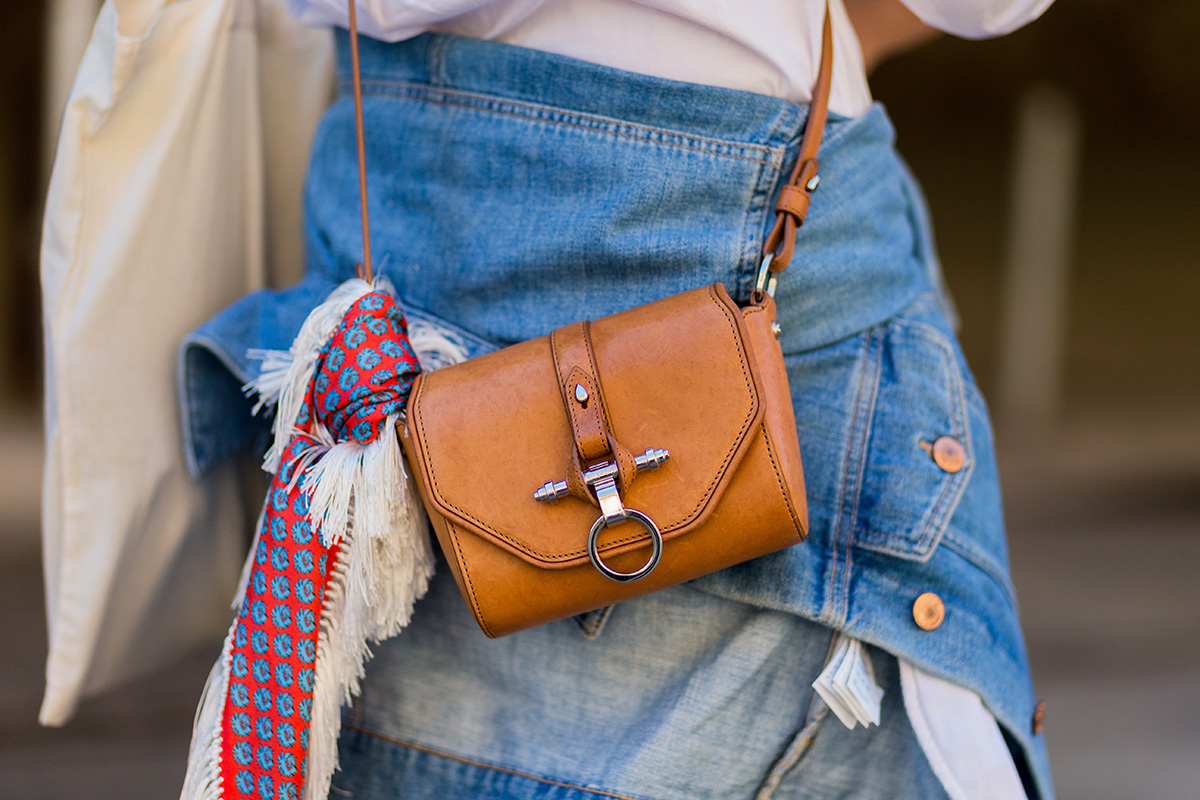 A fringe-y, boho-inspired scarf plays well with a mini leather crossbody.