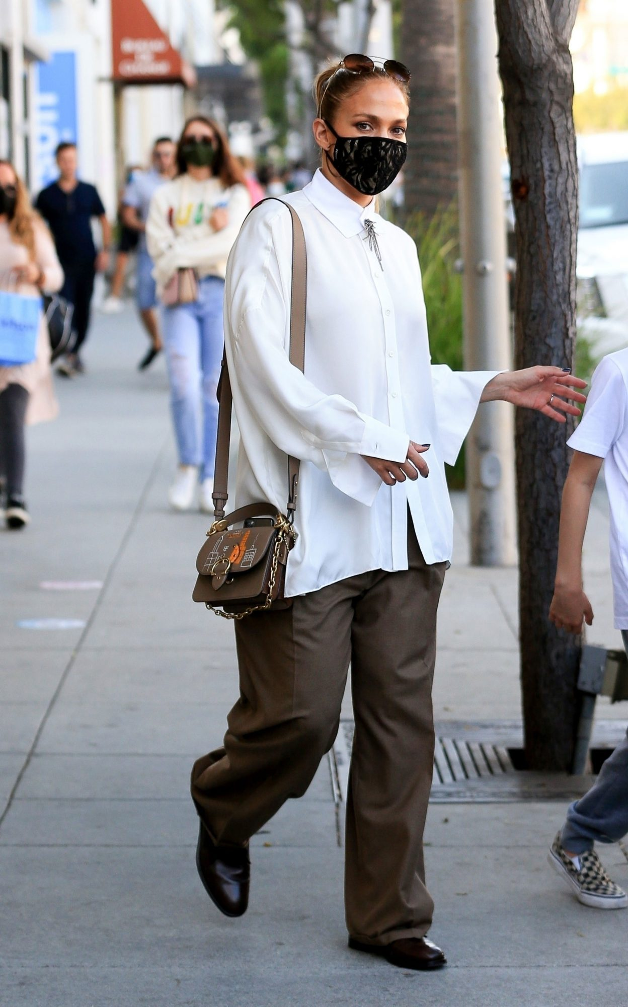 Jennifer Lopez Wearing a New Coach Bag