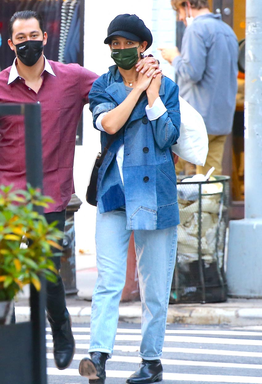 Katie Holmes wearing a Canadian tuxedo and a newsboy cap.