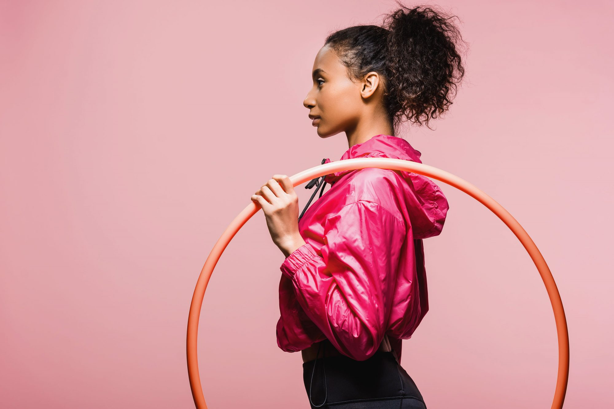 Here's What You Need to Know About the Weighted Hula Hoop Trend