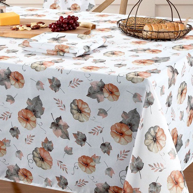 pumpkin and leaf pattern table cloth on table