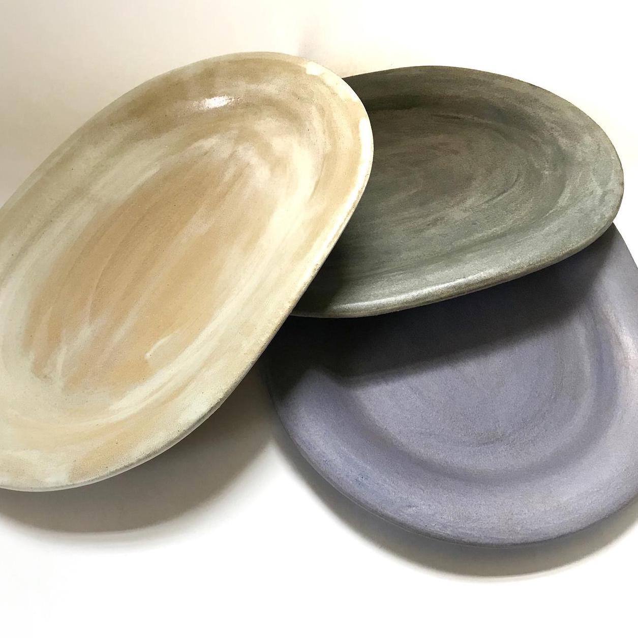 stack of three ceramic platters