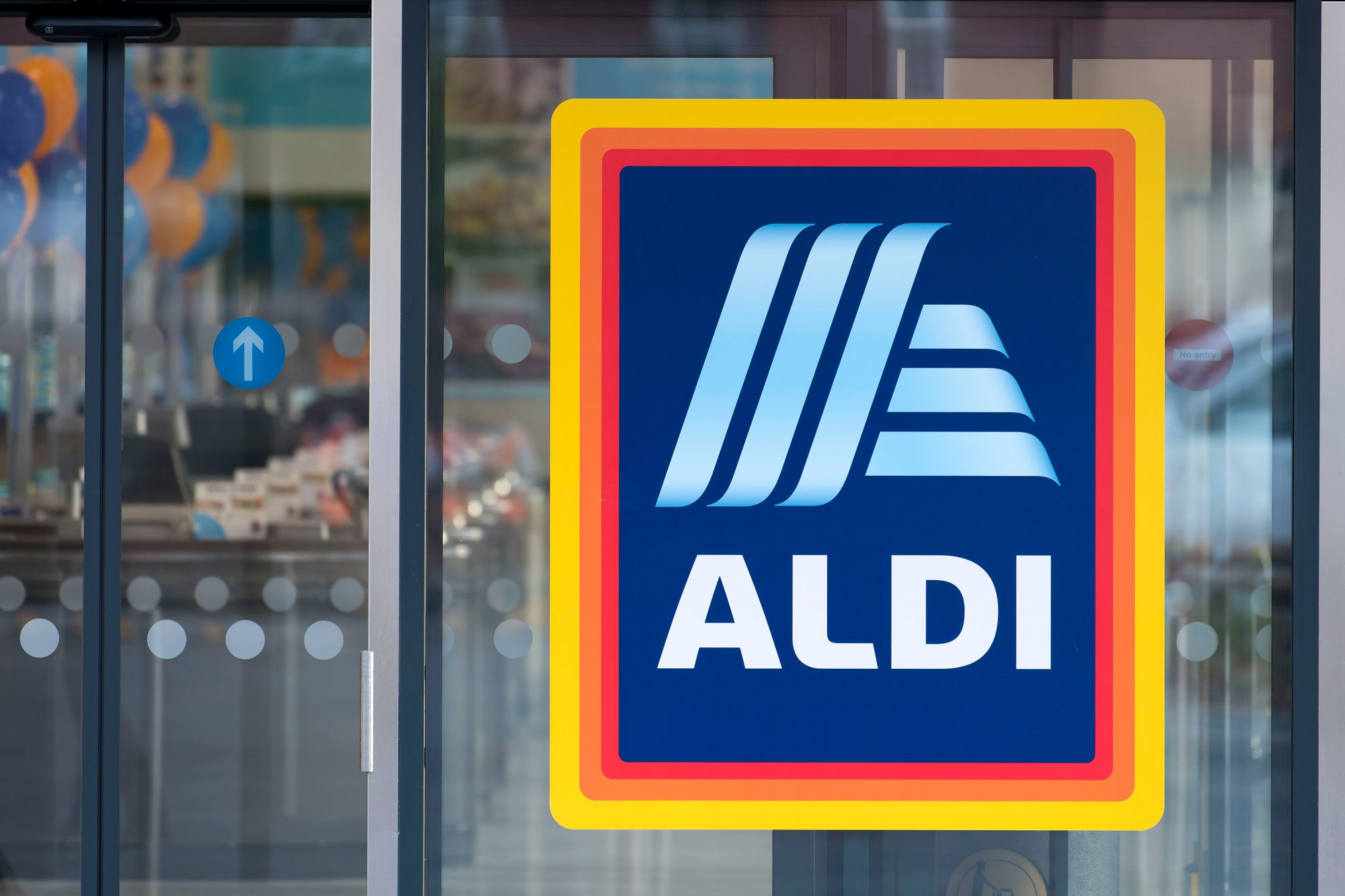 an aldi store sign on a glass window