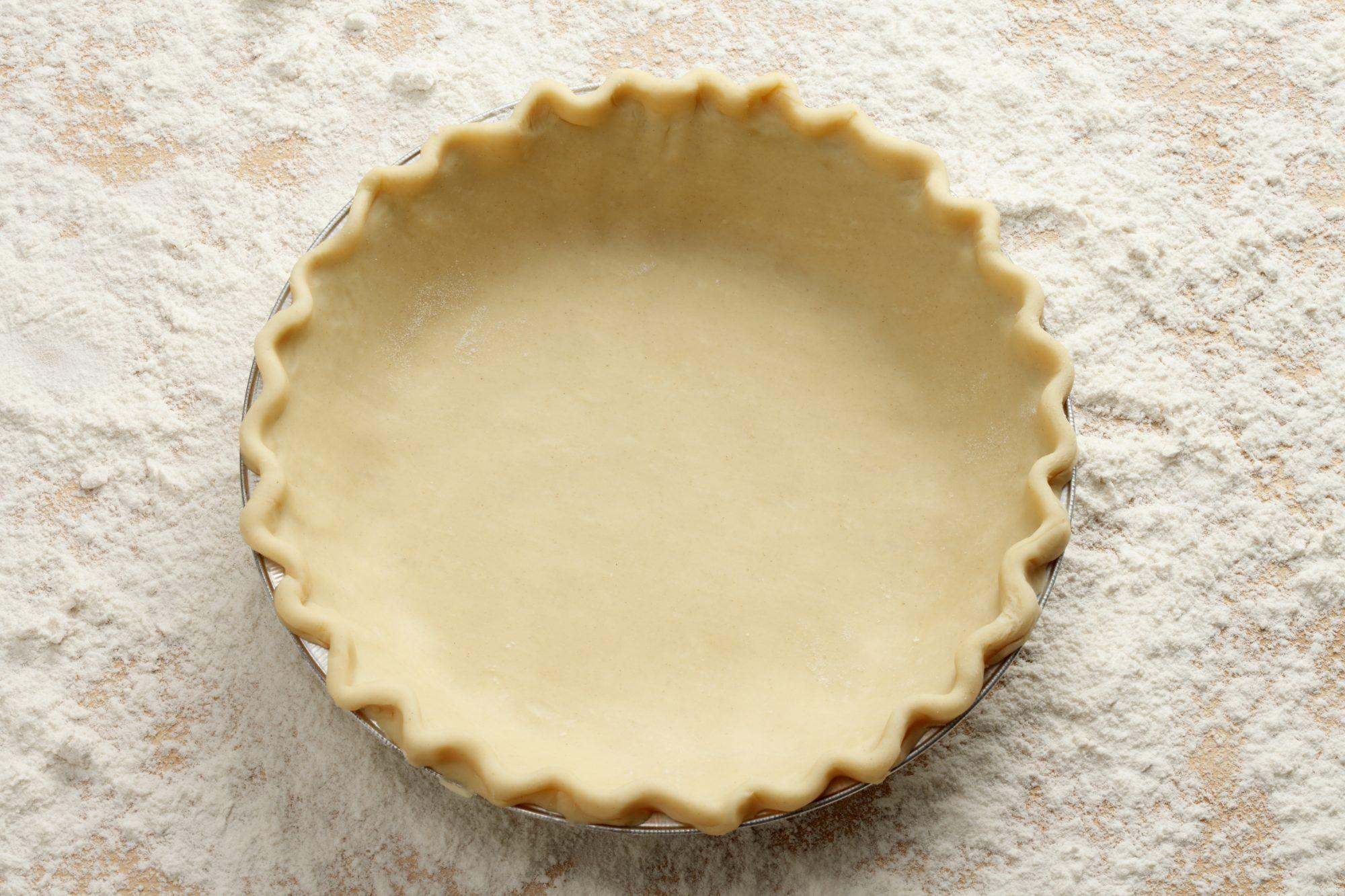 Empty Pie Crust with flour background