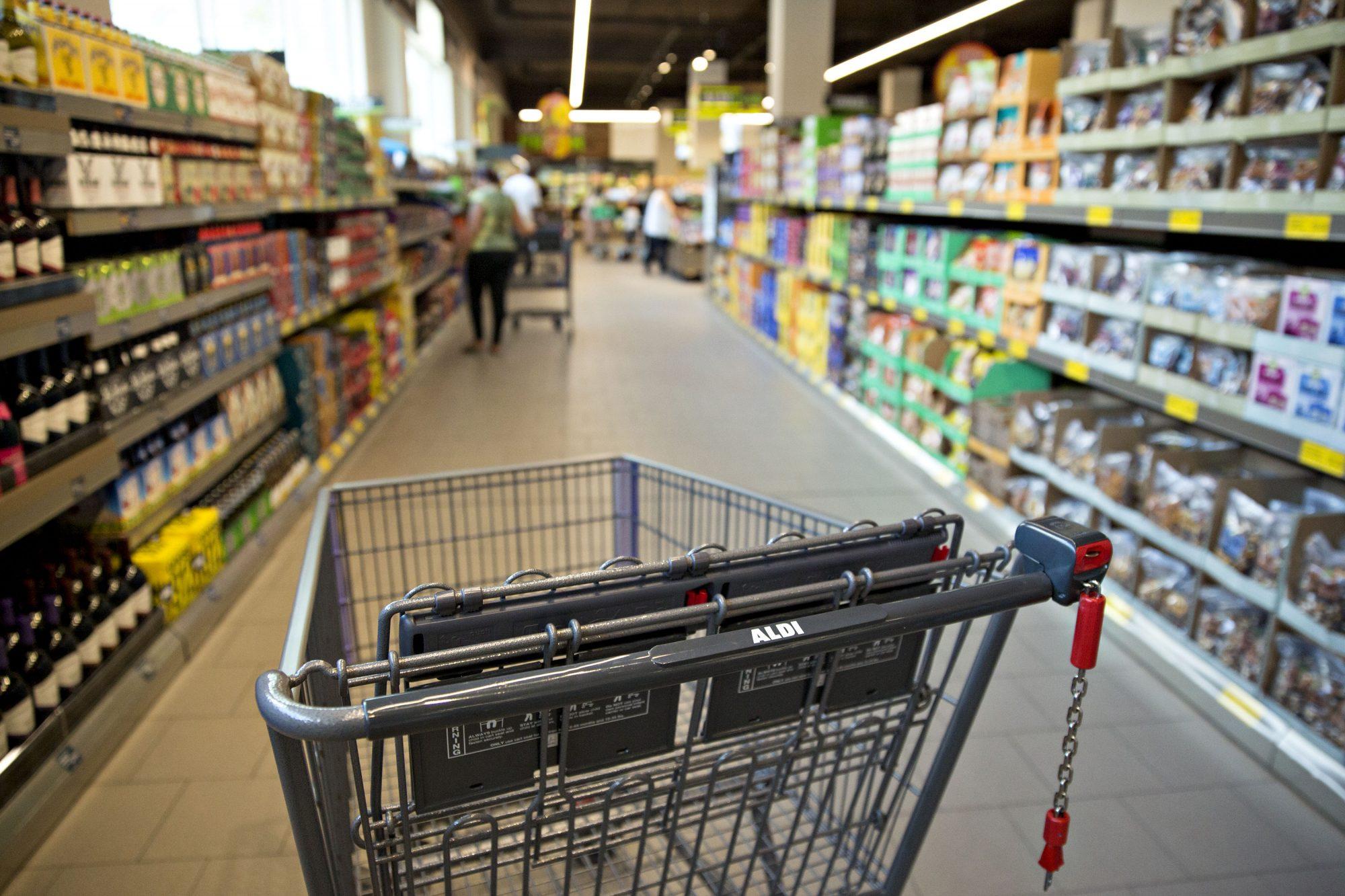 inside an aldi aisle with a shopping cart
