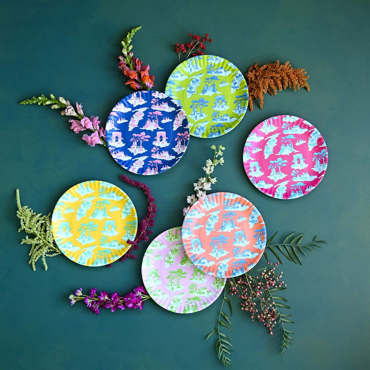 Set of six patterned plate on teal background with flowers