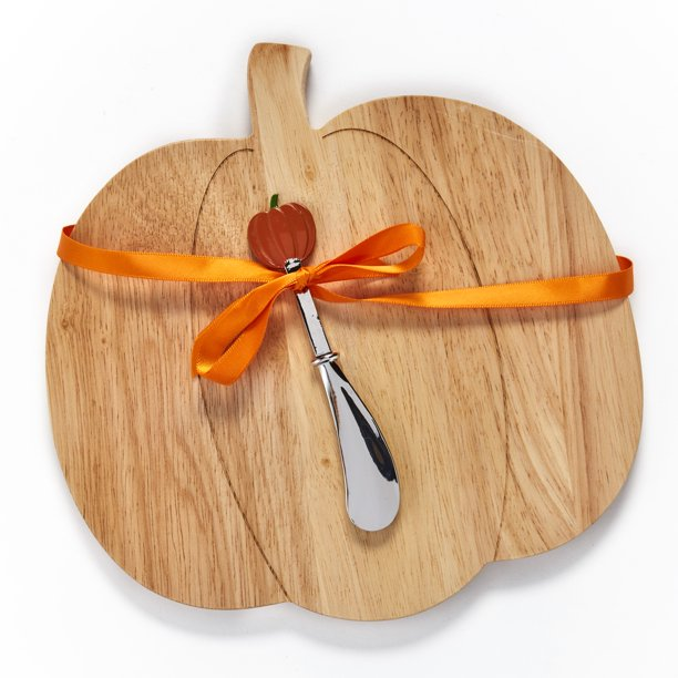 pumpkin shaped charcuterie board with stainless steel spreader with orange pumpkin tip