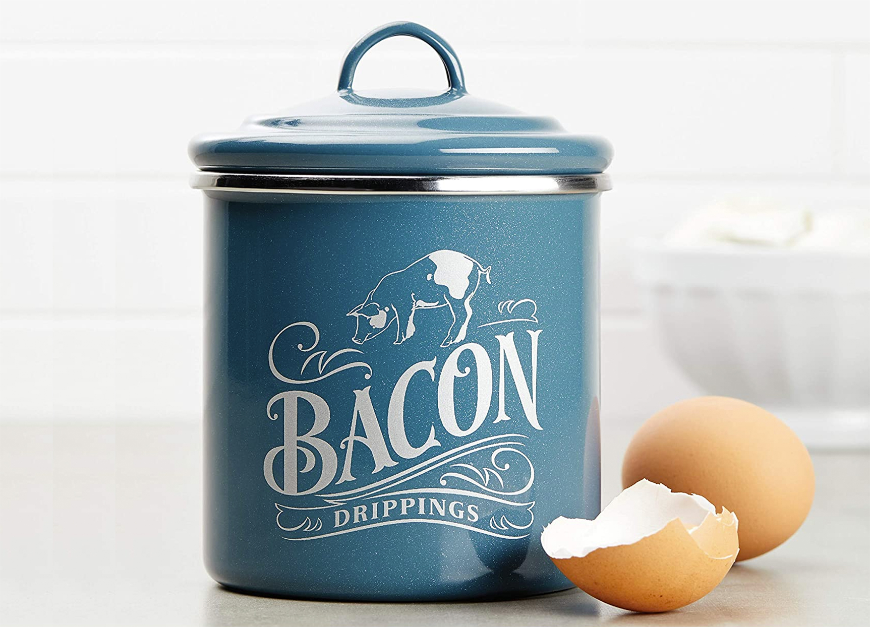 Ayesha Curry bacon drippings container in blue on kitchen counter