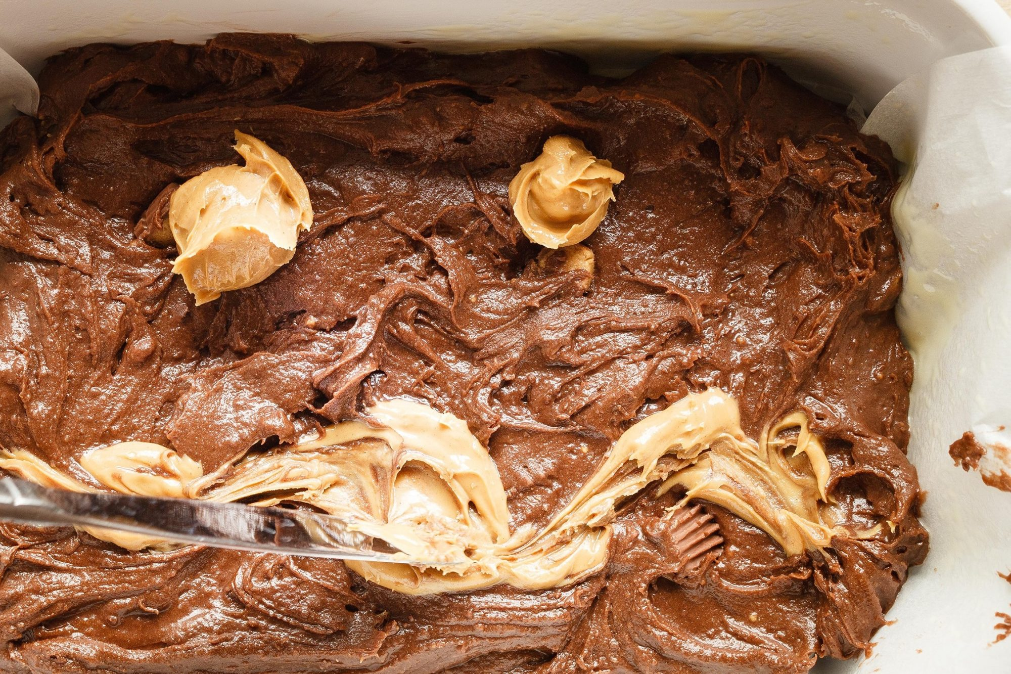 swirling peanut butter into brownie mix