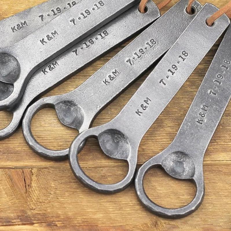 several custom engraved bottle openers