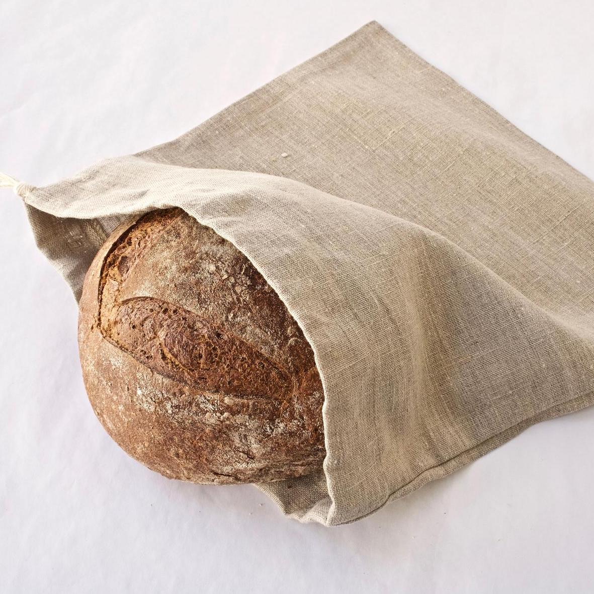 linen bread bag with a boule inside