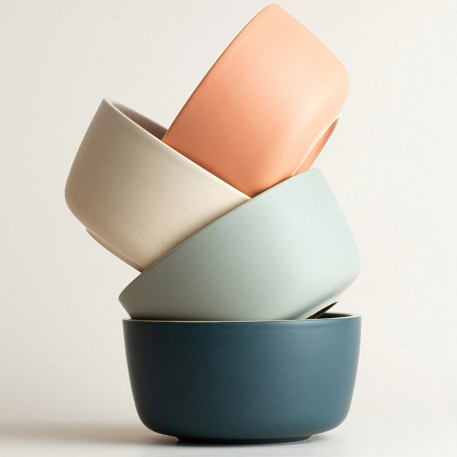 stack of matte ceramic bowls