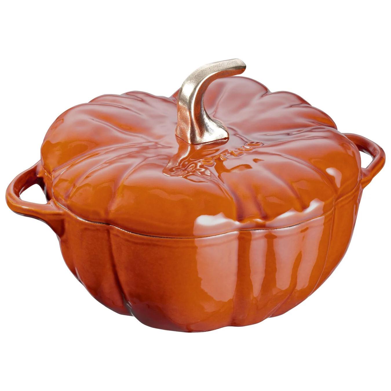 orange pumpkin-shaped Dutch oven on white background