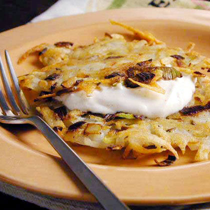 Leek, Potato, and Caraway Latkes with Spiced Sour Cream