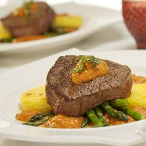 Pan Seared Medallions of Beef Over Polenta With Creamy Tomato Sauce
