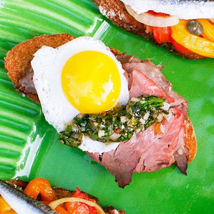 Picnic Crostini with Roast Beef, Chimichurri, and Quail Egg