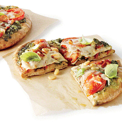 Pita Pizzas with Kale Pesto, Tomatoes, and Bacon