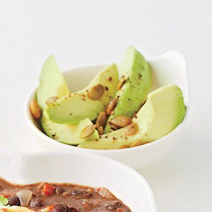 Sliced Avocado with Pepitas and Lime