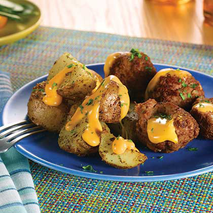 VELVEETA® Slow Cooker Cheesy Stuffed Meatballs and Potatoes [Ad]
