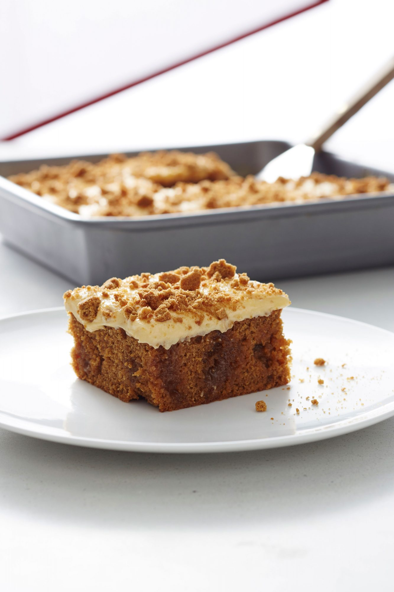 Salted Caramel Gingerbread Poke Cake with Pumpkin Cream Cheese Frosting image