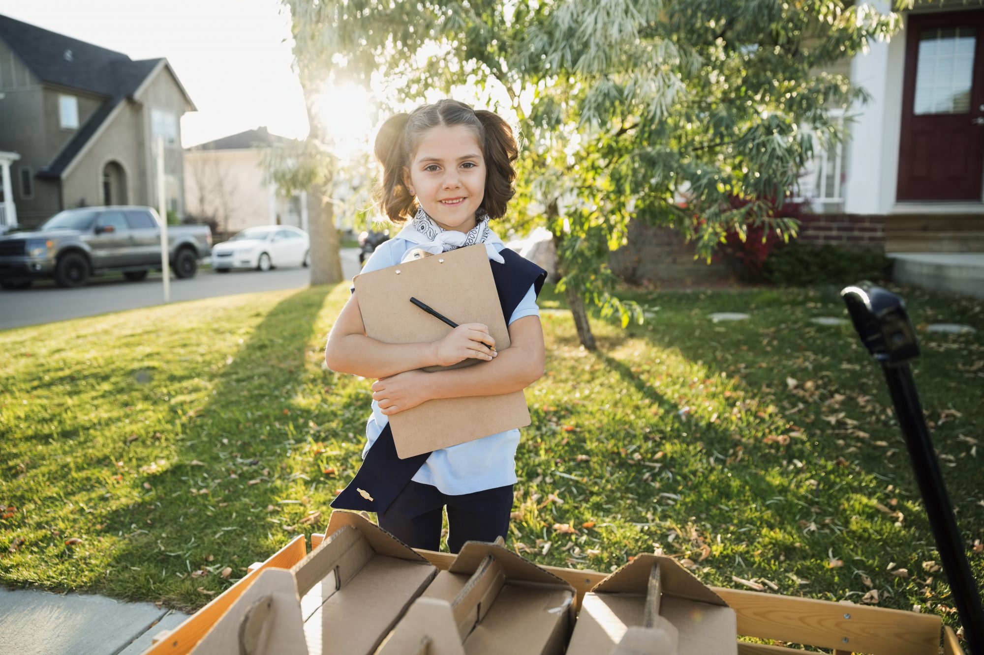 Girl Scout Delivering Cookie Boxes
