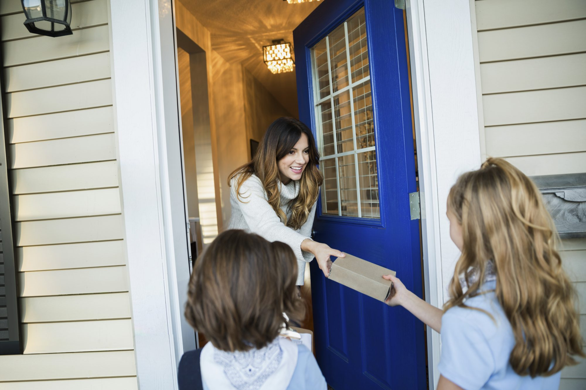 Girl Scouts Delivering Cookies