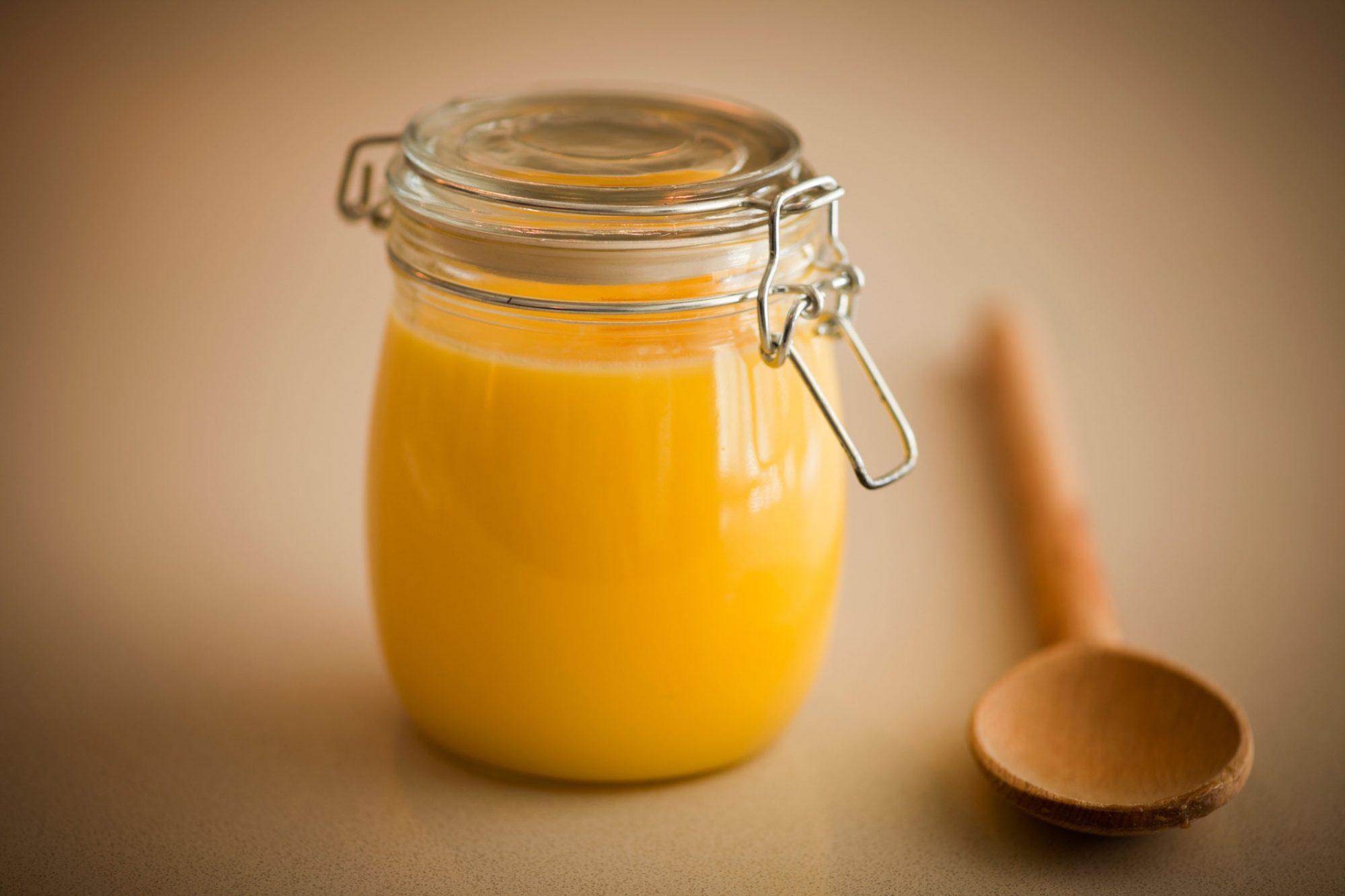 Jar of Ghee and Spoon image