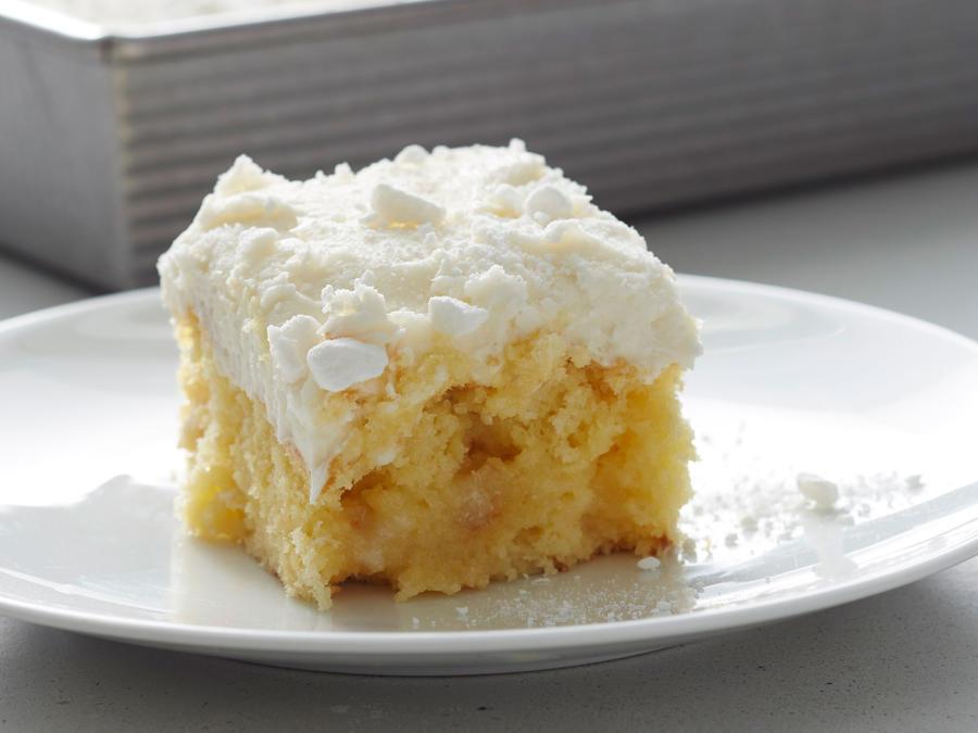 Vanilla Buttermilk Poke Cake with Buttercream Frosting