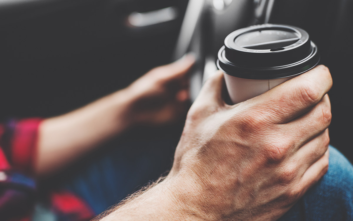 EC:  assets%2Fmessage-editor%2F1482947917019-hand-car-coffee-driving-inline