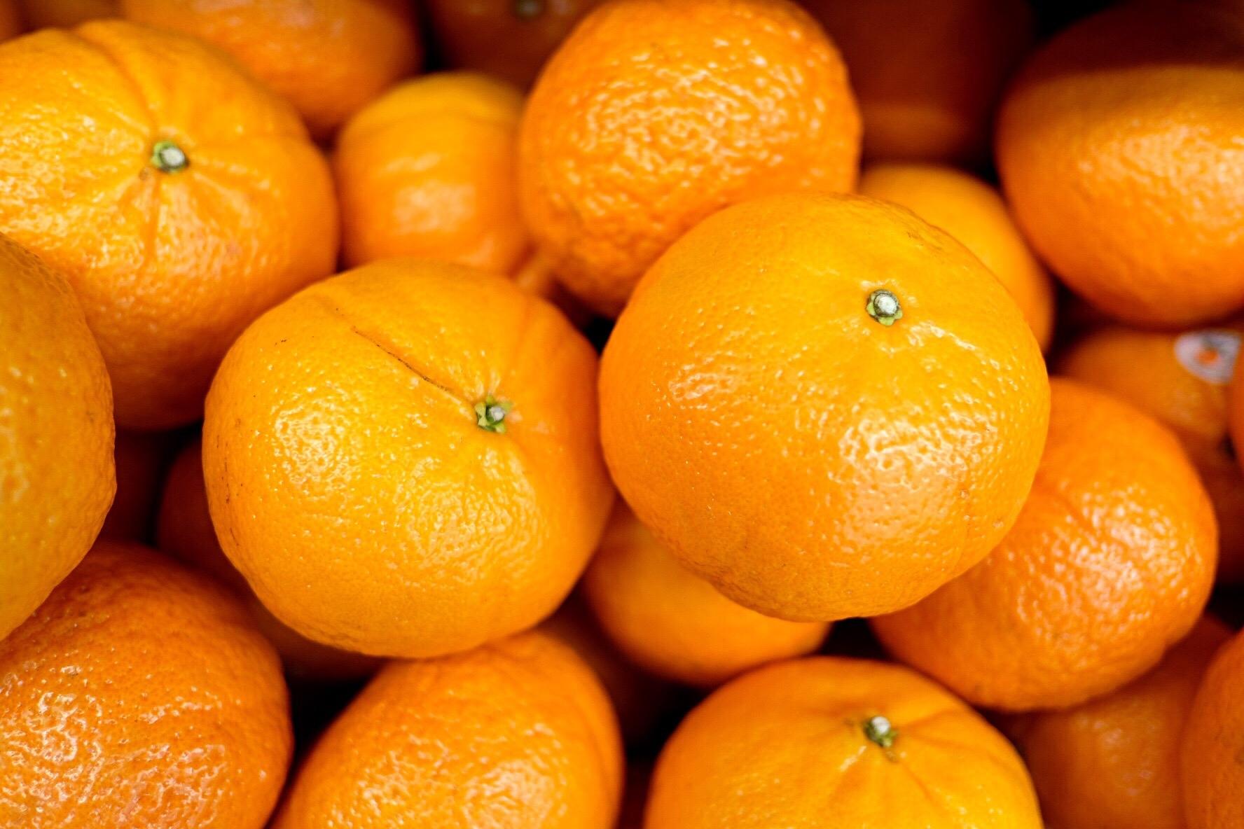 Full Frame Shot Of Oranges For Sale At Market Stall