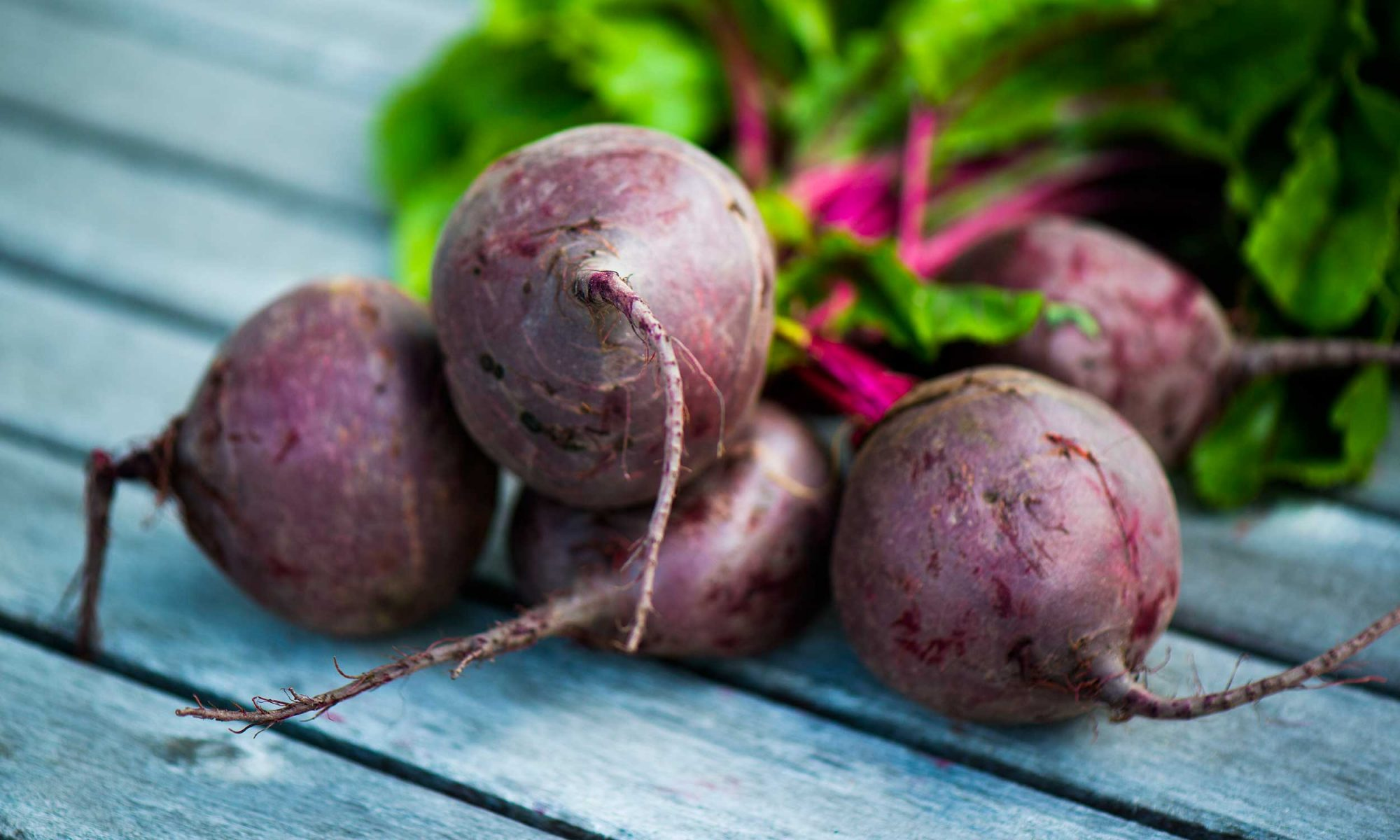bunch of beets on wooden table