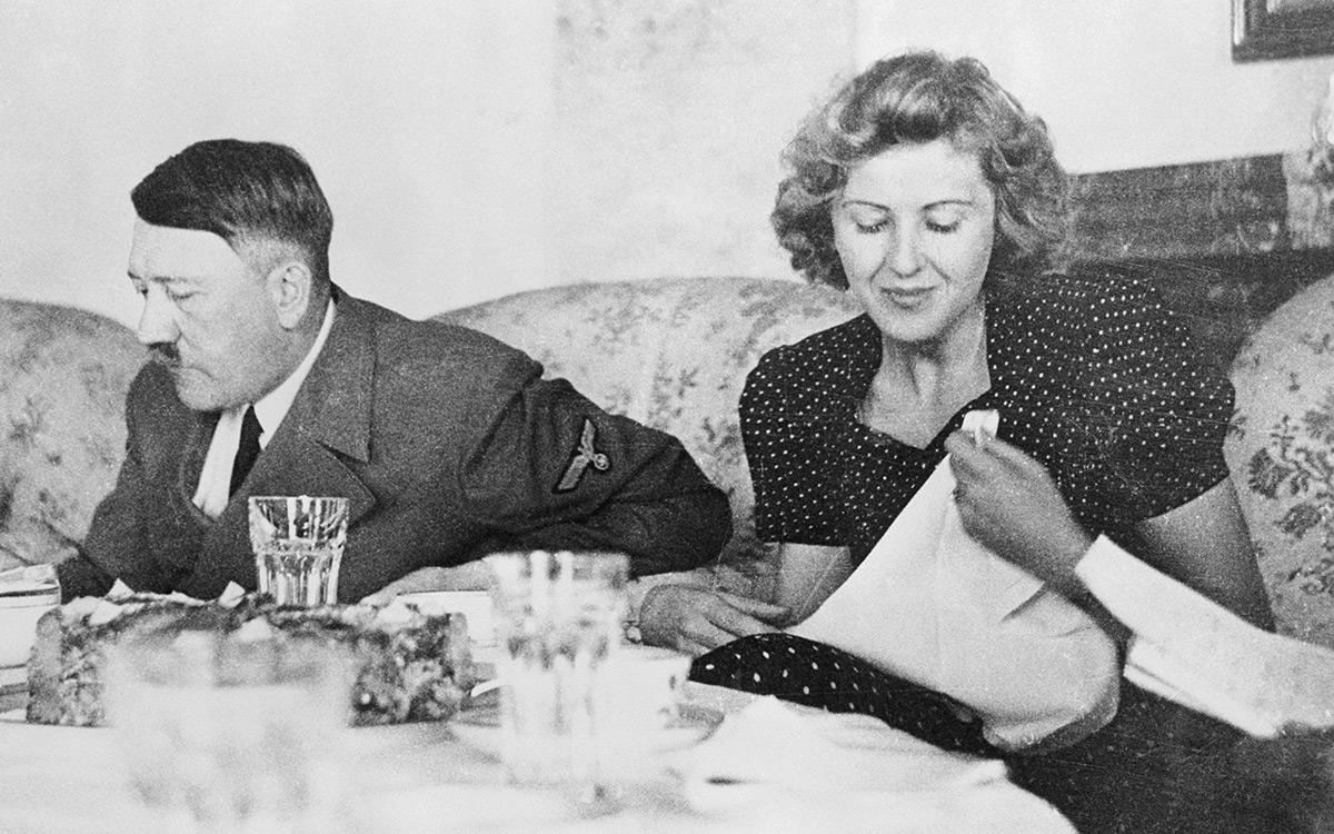 Eva Braun and Adolf Hitler eating