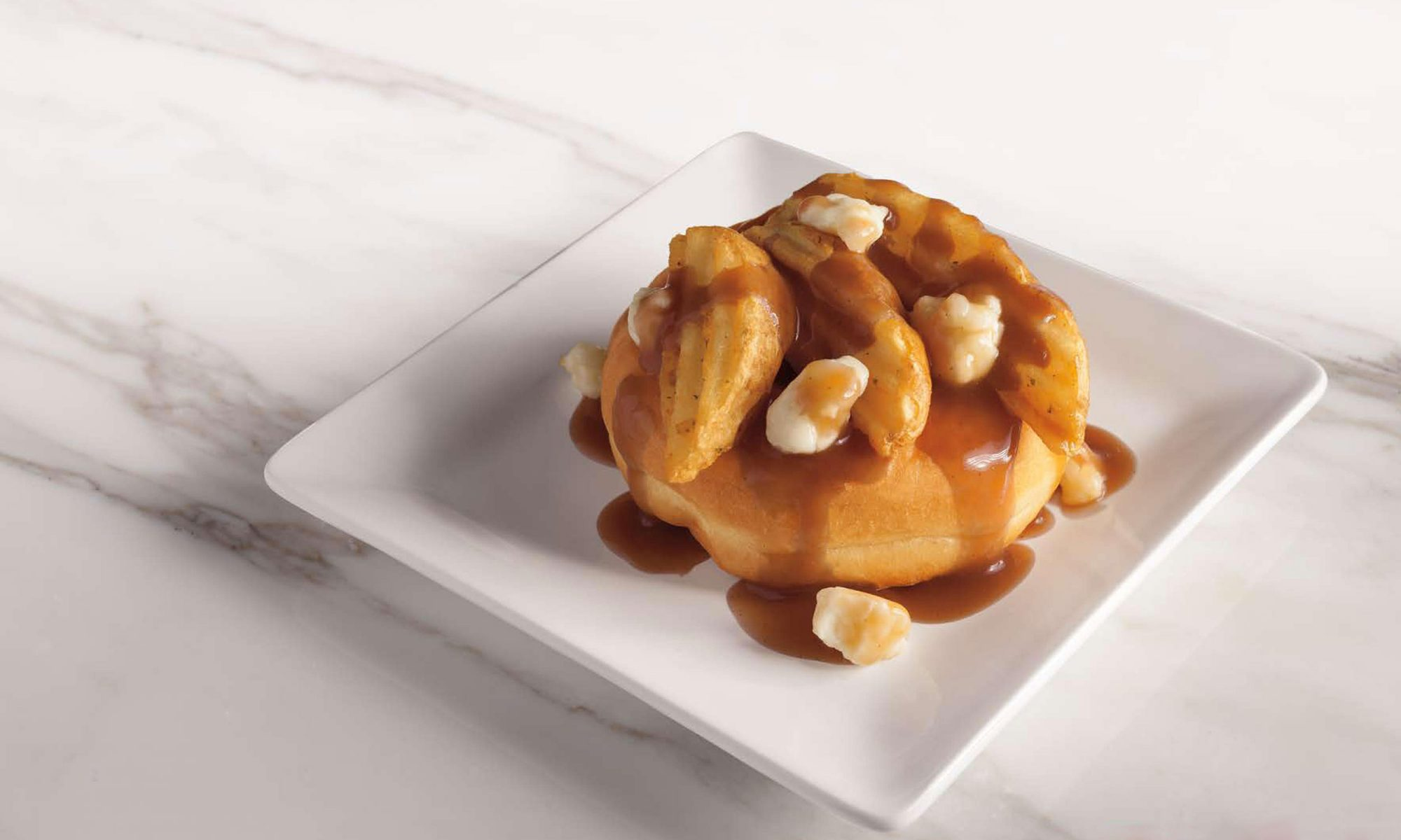 EC: The New Tim Hortons Poutine Doughnut Is Peak Canada
