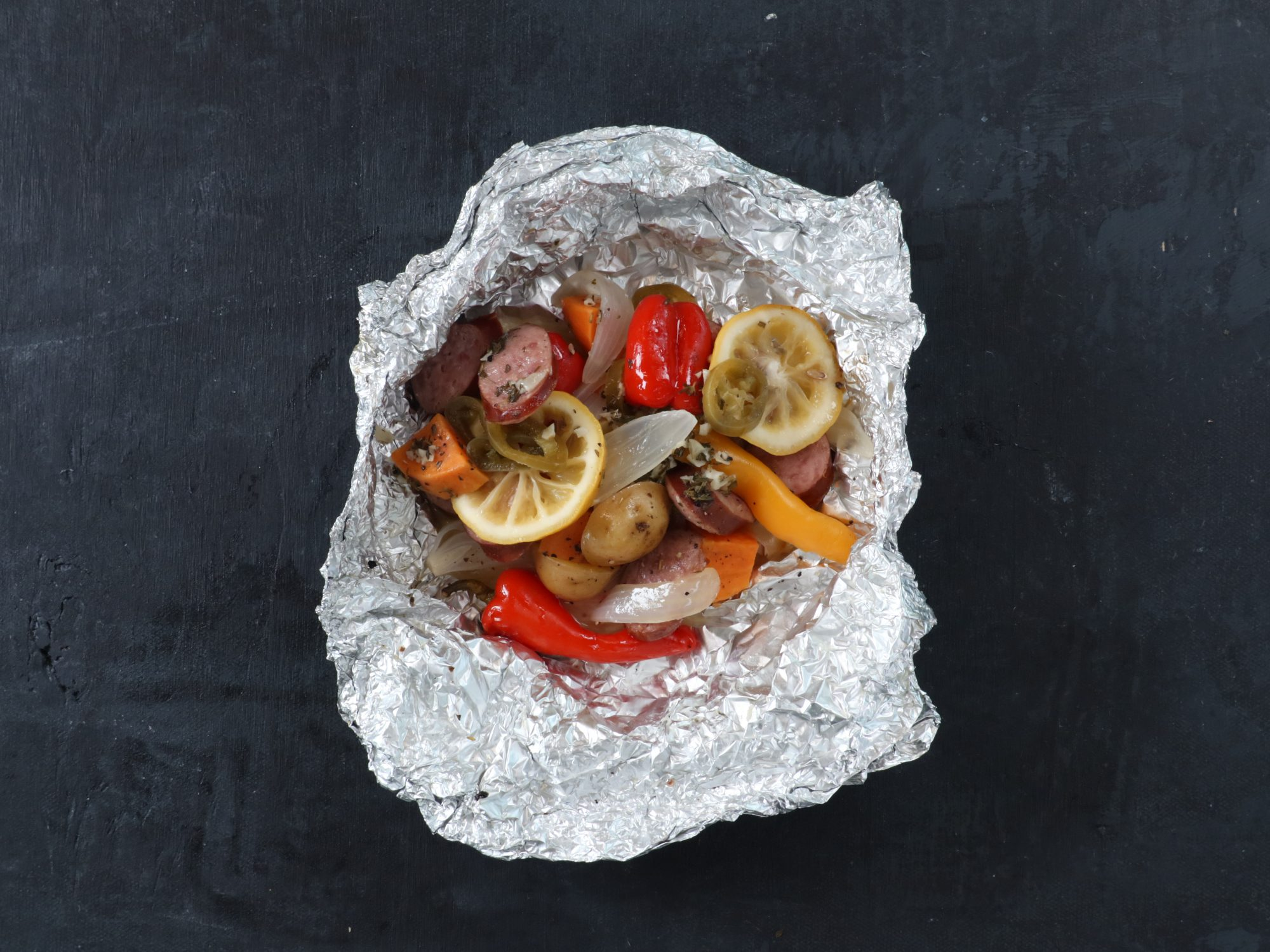 Foil Packets with Sausage, Potatoes, and Peppers