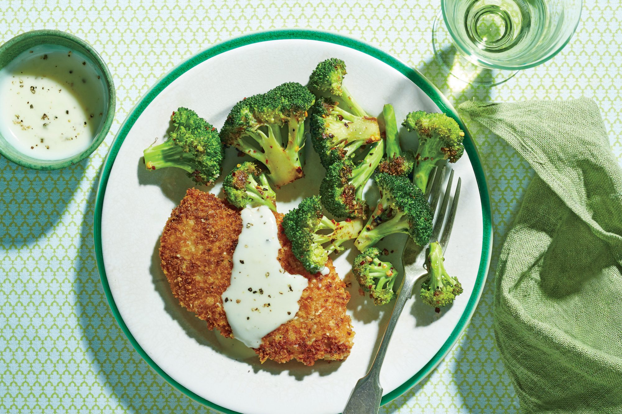 Crispy Oven-Fried Chicken Cutlets with Roasted Broccoli and Parmesan Cream Sauce