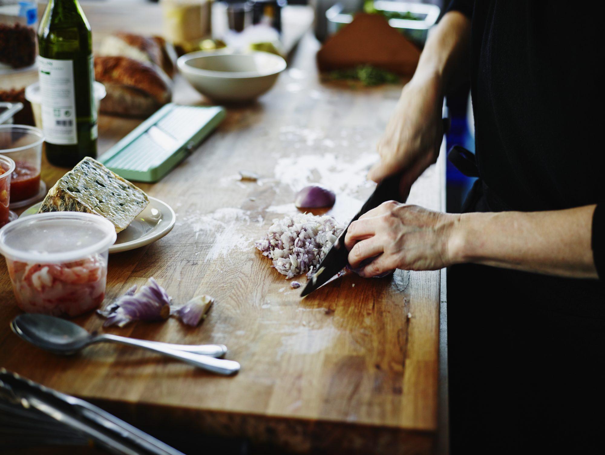 Chopping onion on butcher block countertop